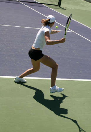 raquet: Woman playing tennis at the professional tournament Stock Photo