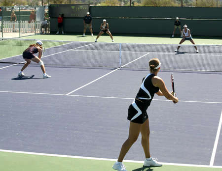 matches: Four women playing doubles at the professional tournament
