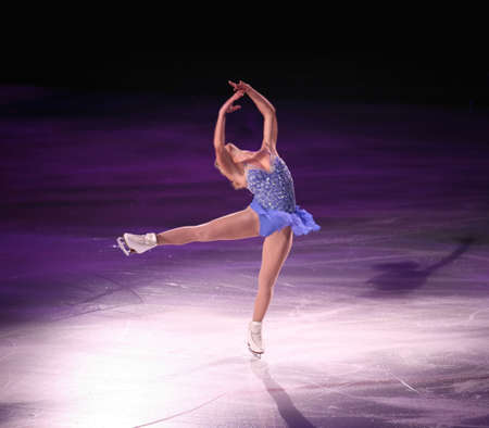 figure skater: Professional woman figure skater performing at Stars on ice show