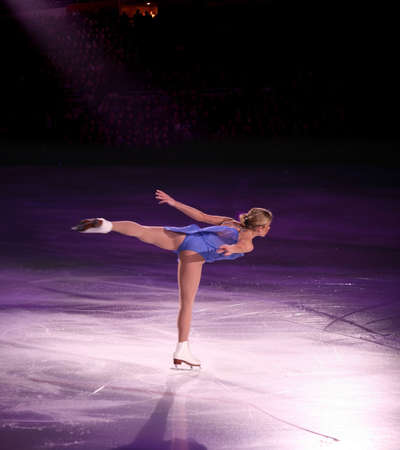 skater: Professional woman figure skater performing at Stars on ice show