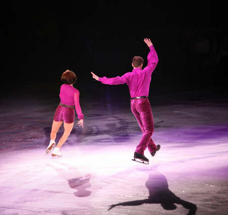 Professional man and woman figure skaters performing at Stars on ice show