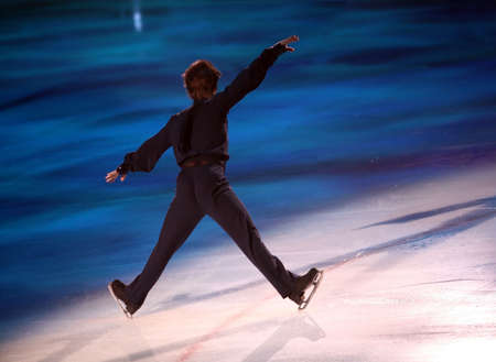 Professional man figure skater performing at Stars on ice show Stock Photo