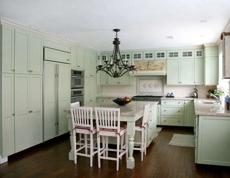 Country style pistachio  kitchen with island