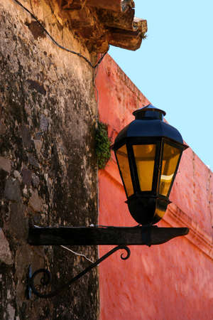 Lamp on the old wall in Colonia, Uruguay Imagens - 881622