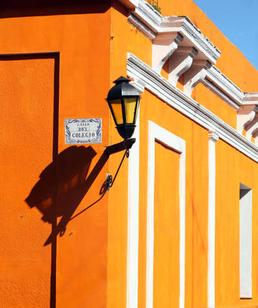 Lamp on the orange wall in Colonia, Uruguay Imagens - 881627