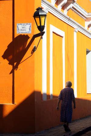 Elderly lady walking on the street in Colonia, Uruguay Imagens - 881628