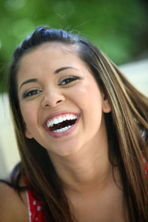 Portrait of a young mexican girl laughing Banco de Imagens