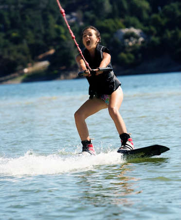 Girl wakeboarding  on the lake