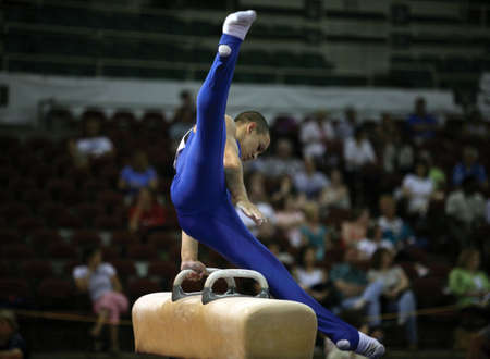 contest: Young man competing on the pommel Stock Photo