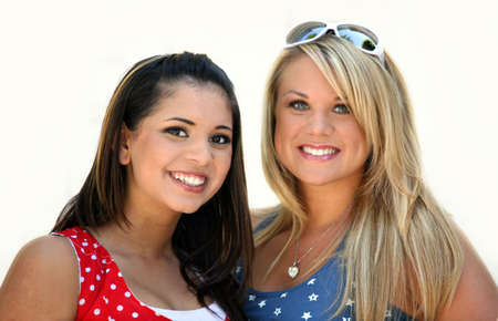 Two smiling girl friends - blond and brunette Stock Photo