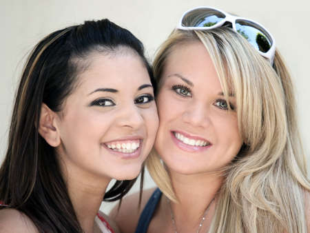 best: Two smiling girl friends - blond and brunette Stock Photo