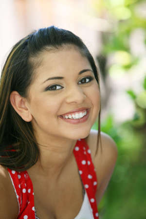 Portrait of a young mexican girl laughing Stockfoto