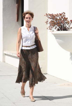 Pretty mature woman walking down the street