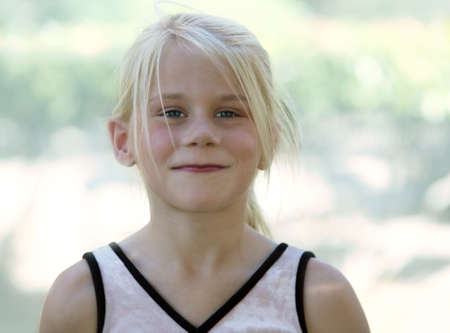 A funny blond girl smiling photo