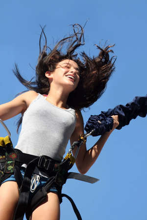 elastic: Girl having a good time bungee jumping