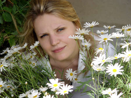 Blond girl with daisies on a sunny day Stock Photo - 2160603