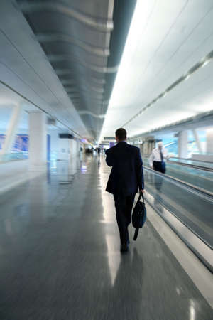 Zoom blur of a businessman at the airport