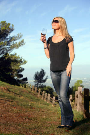 Blond woman enjoying wine at the winery