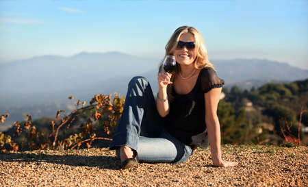 tasting: Blond woman enjoying wine at the winery