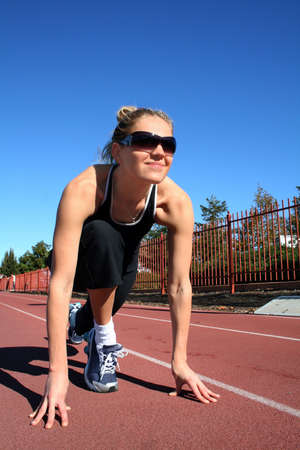 Young pretty woman exercising on a racetrack Stock Photo - 2180977