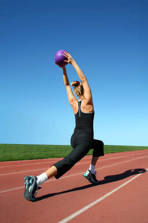 Young pretty woman exercising on a racetrack Stock Photo - 2180966