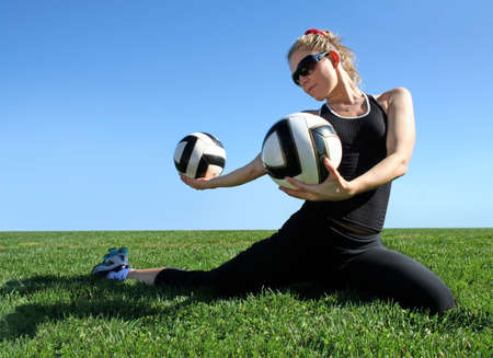 Young pretty woman exercising on green grass Stock Photo - 2180970