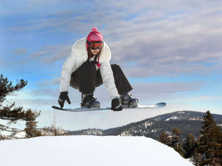 Young mexican girl jumping on a snowboard