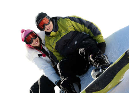 Young happy couple in goggles on snowboards Stock Photo