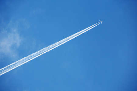 An airplane trail across the sky Stock Photo - 2335616