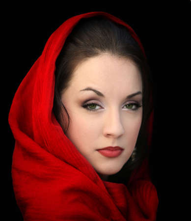 Young woman in a red scarf on black photo