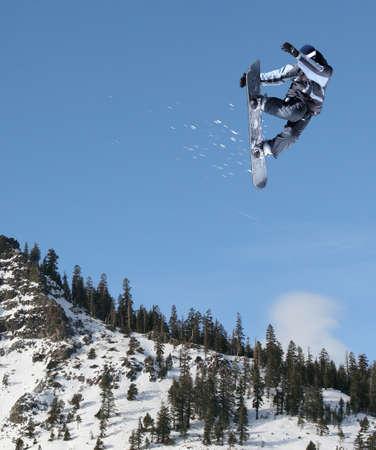 Snowboarder jumping high at Lake Tahoe resort Stockfoto
