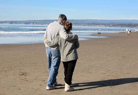A mature couple on walking the beach