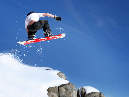 Snowboarder jumping high in the air Stockfoto