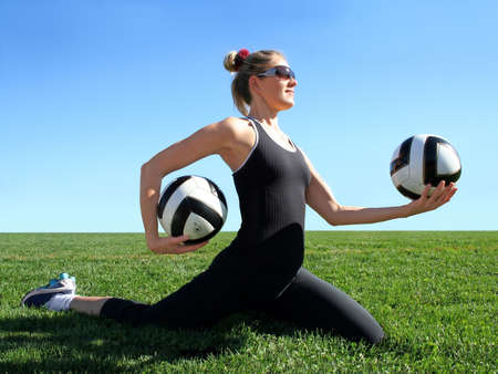 Young pretty woman exercising on green grass Stock Photo - 2587561