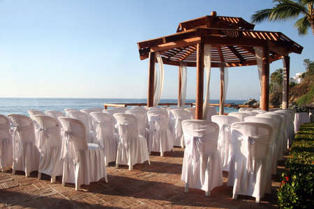 christian marriage: Tropical settings for a wedding on a beach Stock Photo