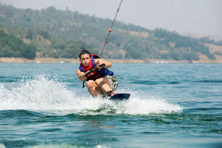 water skiing: Young wakeboarder