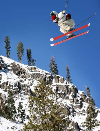A young man jumping high at Lake Tahoe resort Stock Photo