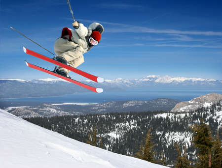 A young man jumping high at Lake Tahoe resort Stock Photo