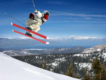 A young man jumping high at Lake Tahoe resort Stockfoto
