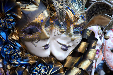 theatre masks: Row of venetian masks in gold and blue  Stock Photo