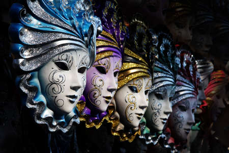 Row of venetian masks in gold and blue  Stok Fotoğraf