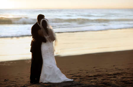 Couple wedding on the beach at sunset