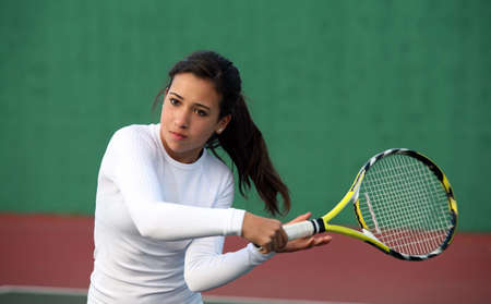 Teenage girl playing tennis
