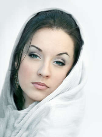 Young woman in a white scarf  photo
