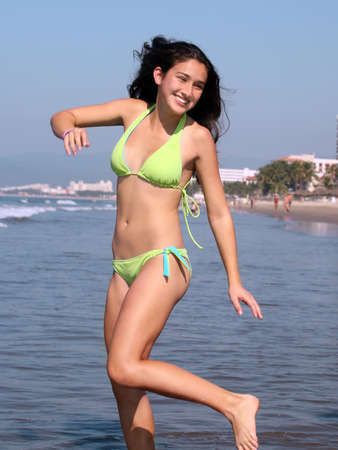 A teenage girl is having good time on the beach Foto de archivo