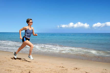 Young woman running alone on the beach Stock Photo - 3974456