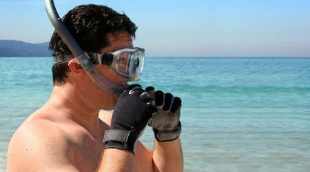 Man is about to go snorkeling in the ocean photo