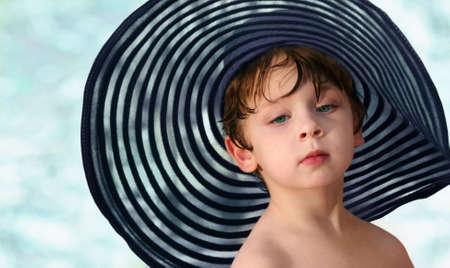 A little boy in a big blue hat photo