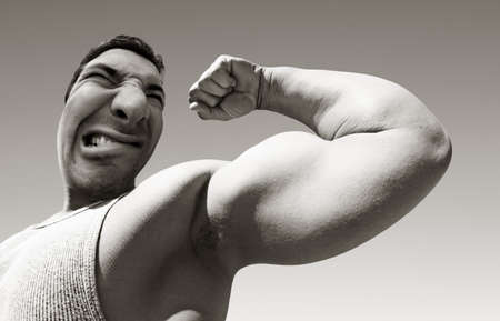An ugly mean man with big muscles Stock Photo