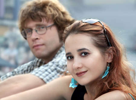A beautiful young woman and a man in glasses photo